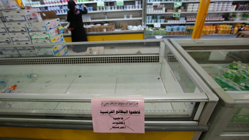 A notice calling for a boycott of French products is displayed at a supermarket in Sanaa, Yemen, Monday, Oct. 26, 2020. Muslims in the Middle East and beyond on Monday called for boycotts of French products and for protests over caricatures of the Prophet Muhammad they deem insulting and blasphemous, but France's president has vowed his country will not back down from its secular ideals and defense of free speech. (AP Photo/Hani Mohammed)