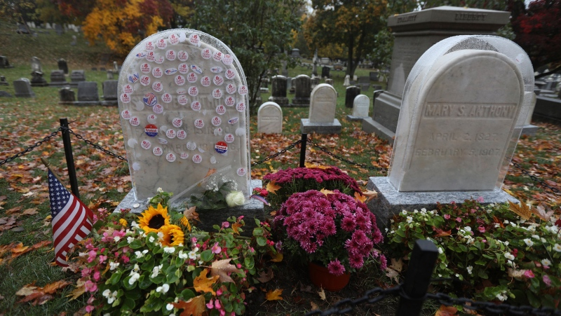 'I Voted Today' stickers cover a protective plastic cover on the headstone of Susan B. Anthony in Mt. Hope Cemetery, Sunday Oct. 25, 2020. in Rochester, N.Y. (Tina MacIntyre-Yee/Democrat & Chronicle via AP)