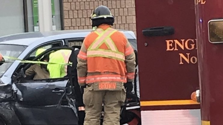 Firefighters work to help a driver out of their car after a crash on York Street at Lyle Street. (Supplied by London Fire Department)