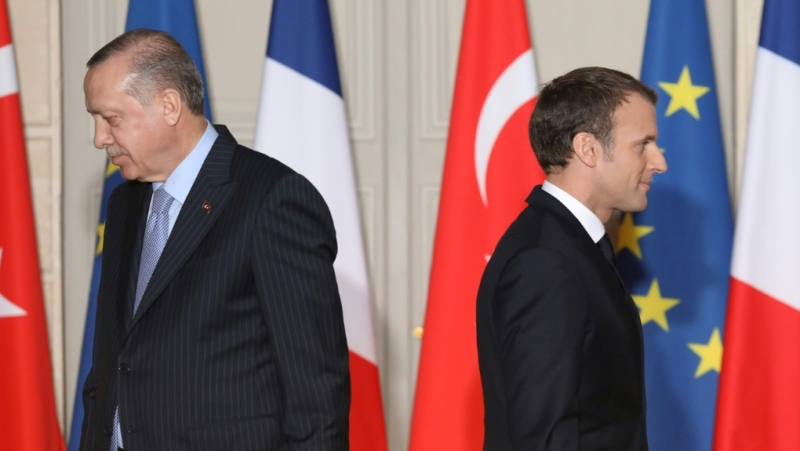 French President Emmanuel Macron (R) and Turkish President Recep Tayyip Erdogan clash on Syria, Libya, a scramble for natural gas in the Mediterranean and Macron's battle against extremism. (AFP)