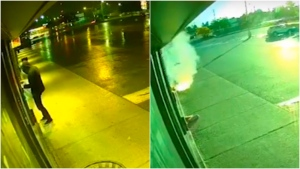 Video surveillance footage released by police shows someone putting a package in front of a store and then the package bursts into flame. (Durham Regional Police)