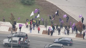 Protestors hold a rally outside Southlake Regional Health Centre in Newmarket, Ont., on Mon., Oct. 26, 2020.