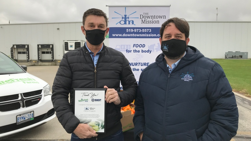 Peter Quiring, of Nature Fresh Farms, was given a Recognition Award from the Downtown Mission's Ron Dunn in Windsor, Ont. on Monday, Oct. 26 2020.