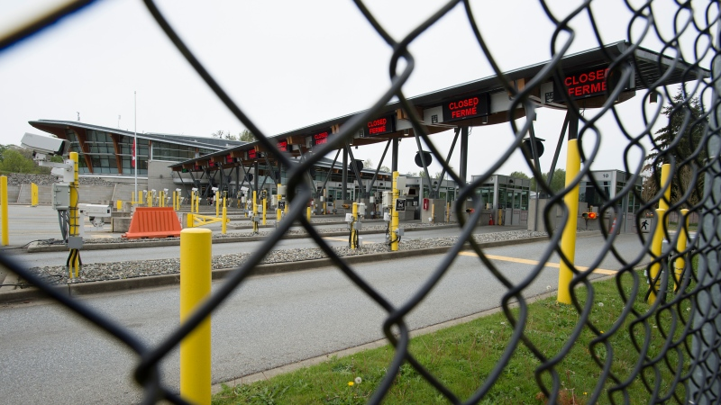 Part of Canada's land border with the United States is pictured closed at the Peace Arch border crossing in Surrey, B.C., Tuesday, April 28, 2020. RCMP in British Columbia say four Americans have been fined $500 for violating emergency orders under the Quarantine Act, invoked in order to limit the spread of COVID-19.THE CANADIAN PRESS/Jonathan Hayward
