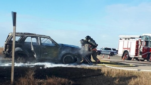 A vehicle fire sparked a grassfire near Cathedral Bluffs northeast of Saskatoon. Photo by the Saskatoon Fire Department