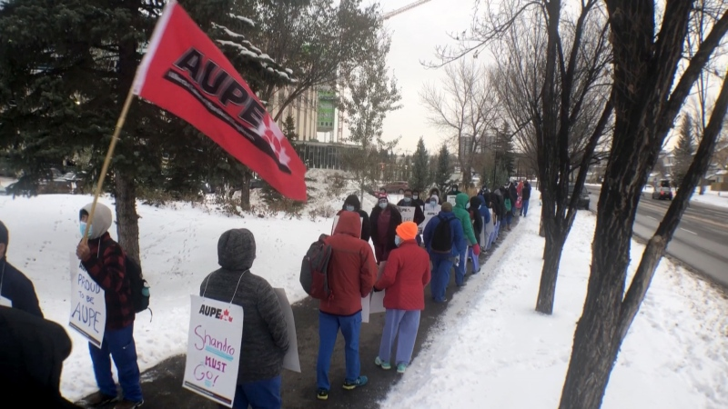 Laundry workers, housekeeping staff and dietary aids took to the street in front of hospitals across the province on Monday to protest the province's plan to lay off 11,000 workers in a move toward privatizing many heath-care jobs in the province.