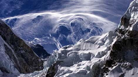 In this Saturday May 24, 2003 file photo, wispy clouds form near the peaks surrounding Mount Everest, seen from Everest Base camp in Nepal. (THE ASSOCIATED PRESS/Gurinder Osan, File)
