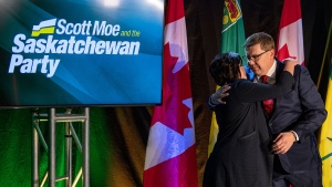 Saskatchewan Party Leader Scott Moe embraces wife Krista during his victory speech to media at the party's campaign event in Saskatoon, Sask., Monday, Oct. 26, 2020. THE CANADIAN PRESS/Liam Richards