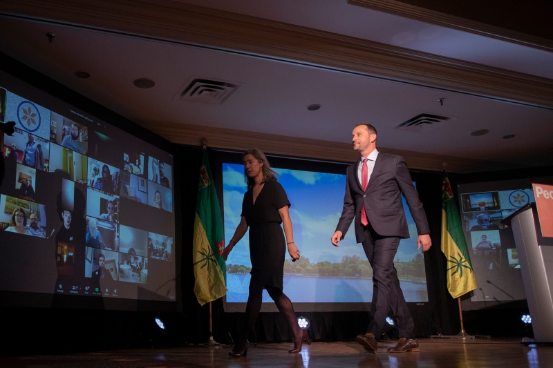 NDP Leader Ryan Meili, right, and his wife Mahli Brindamour walk off stage at the Saskatchewan NDP election night headquarters at the Delta Marriott Saskatoon Downtown in Saskatoon, Sask on Monday, October 26, 2020. THE CANADIAN PRESS/Kayle Neis