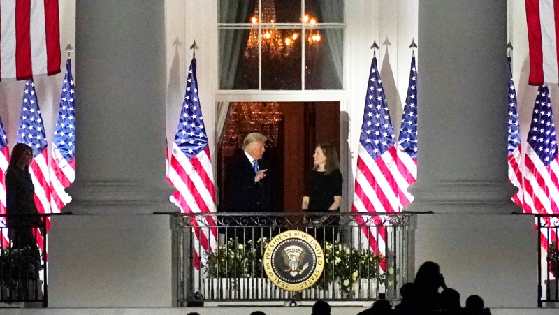 U.S. President Donald Trump and Supreme Court Justice Amy Coney Barrett stand together at the White House White House in Washington, Monday, Oct. 26, 2017, after a public swearing-in ceremony for Barrett. (AP Photo/Carolyn Kaster)