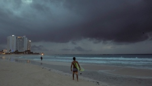 Clouds gather over Playa Gaviota Azul as Zeta approaches Cancun, Mexico, early Monday morning, Oct. 26, 2020. (AP Photo/Victor Ruiz Garcia)