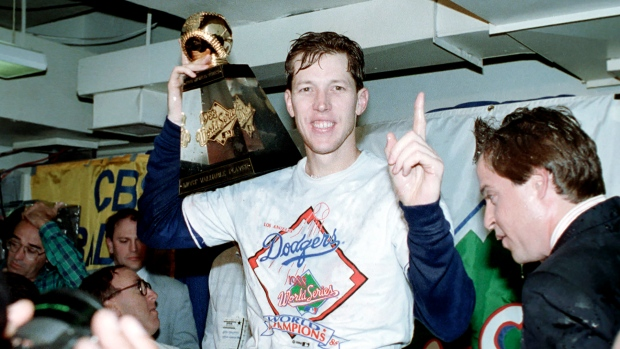 In this Oct. 20, 1988, file photo, Los Angeles Dodgers pitcher Orel Hershiser holds his World Series Most Valuable Player trophy following the Dodgers' decisive 5-2 win over the Oakland Athletics in Oakland, Ca. (AP Photo/Lennox McLendon, File)