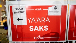 A sign with COVD-19 protocols is seen outside the campaign office of Liberal candidate Ya'ara Saks in the York Centre riding before the polls close in the federal by election in Toronto on Monday, October 26, 2020. (THE CANADIAN PRESS/Carlos Osorio)