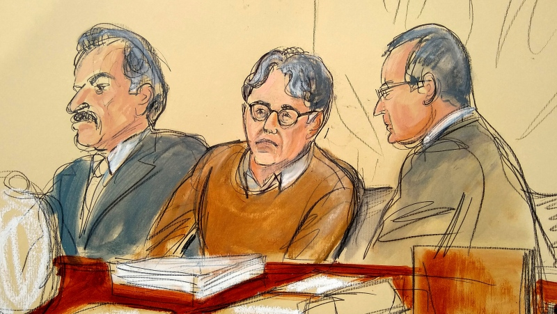 In this Tuesday, May 7, 2019, file courtroom drawing, defendant Keith Raniere, centre, leader of the secretive group NXIVM, is seated between his attorneys Paul DerOhannesian, left, and Marc Agnifilo during the first day of his sex trafficking trial. (Elizabeth Williams via AP, File)
