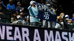 Tampa Bay Rays fans hold up a banner during the ninth inning in Game 5 of the baseball World Series against the Los Angeles Dodgers Sunday, Oct. 25, 2020, in Arlington, Texas. (AP Photo/Tony Gutierrez)