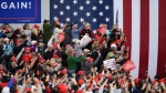 U.S. President Donald Trump supporters take pictures at a campaign rally at the Altoona-Blair County Airport in Martinsburg, Pa, Monday, Oct. 26, 2020. (John Rucosky/The Tribune-Democrat via AP)