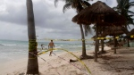 Tape closing off the beach blows in the wind before the arrival of Zeta in Playa del Carmen, Mexico, Monday, Oct. 26, 2020. (AP Photo/Tomas Stargardter)