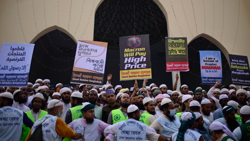 Supporters of Islami Andolan Bangladesh, an Islamist political party, protest against French President Emmanuel Macron and against the publishing of caricatures of the Prophet Muhammad they deem blasphemous, in Dhaka, Bangladesh, Tuesday, Oct. 27, 2020. (AP Photo/Mahmud Hossain Opu)