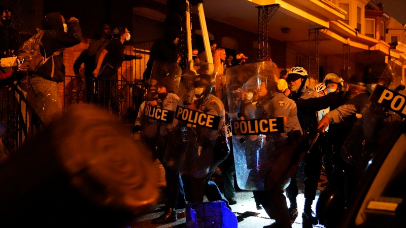 Police officers move in formation during a protest in response to the police shooting of Walter Wallace Jr., Monday, Oct. 26, 2020, in Philadelphia. (Jessica Griffin/The Philadelphia Inquirer via AP)