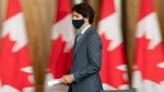 Prime Minister Justin Trudeau arrives for a news conference Tuesday October 20, 2020 in Ottawa. (THE CANADIAN PRESS/Adrian Wyld)
