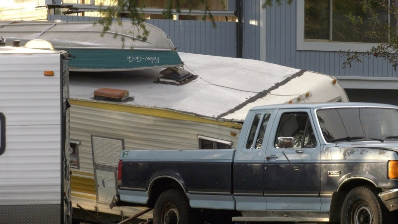 Two men had been trying to get a camper onto the back of a pickup truck when one of the unit's mounting legs collapsed, trapping the man underneath. (CTV News)