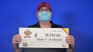 Lotto winner Shane Poisson of Windsor picking up his cheque at the OLG centre in Toronto, Ont. (courtesy OLG)