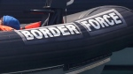 In this file photo dated Saturday Aug. 8, 2020, a Border Force vessel at the port city of Dover, England. Fifteen migrants have been saved Tuesday Oct. 27, 2020, as search and rescue operations by the Border Force continue, but at least four migrants, including a 5-year-old and 8-year-old child, have died Tuesday when their boat capsized while they and other migrants tried to cross the English Channel to Britain, French authorities said. (AP Photo/Kirsty Wigglesworth, FILE)