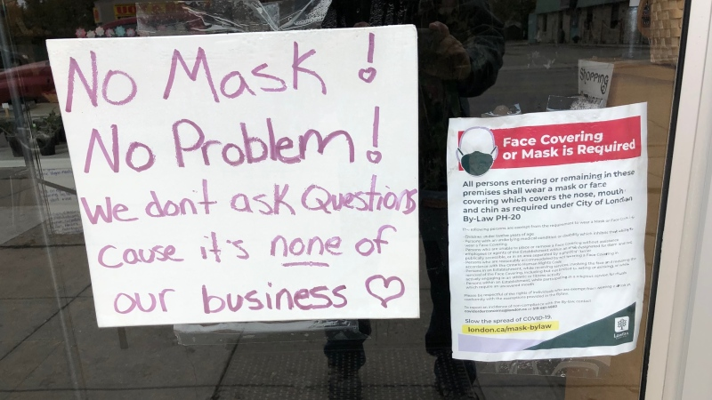A 'No Mask! No Problem' sign hangs in the door of Spirituality in You Healing Centre in London, Ont. on Monday, Oct. 27, 2020. (Jim Knight / CTV News)
