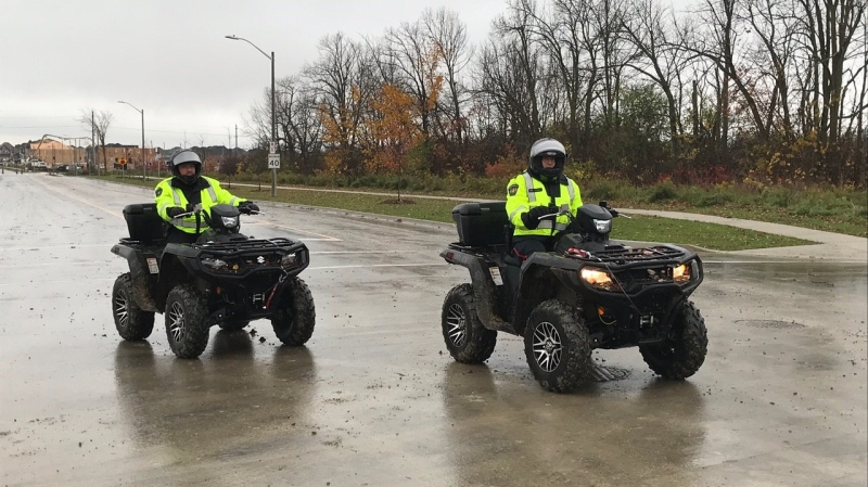 South Simcoe Police officers use ATVs in the search for a missing Bradford teen on Tues., Oct. 27, 2020. (Jim Holmes/CTV News)