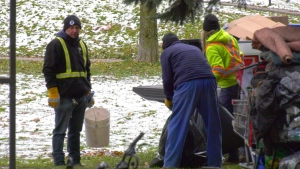 Bylaw officers evicted homeless residents from Memorial Park on Tuesday, with Greater Sudbury Police providing security. (Jaime McKee/CTV News)