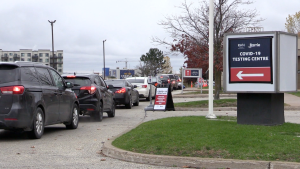 Vehicles line up at the Royal Victoria Regional Health Centre's COVID-19 testing clinic on Sperling Drive in Barrie, Ont. (Mike Arsalides/CTV News)