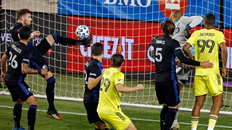 Montreal Impact defender Joel Waterman, back left, makes a save on a shot by Nashville SC during the second half of an MLS soccer match Tuesday, Oct. 27, 2020, in Harrison, N.J. Nashville won 1-0. (AP Photo/Adam Hunger)
