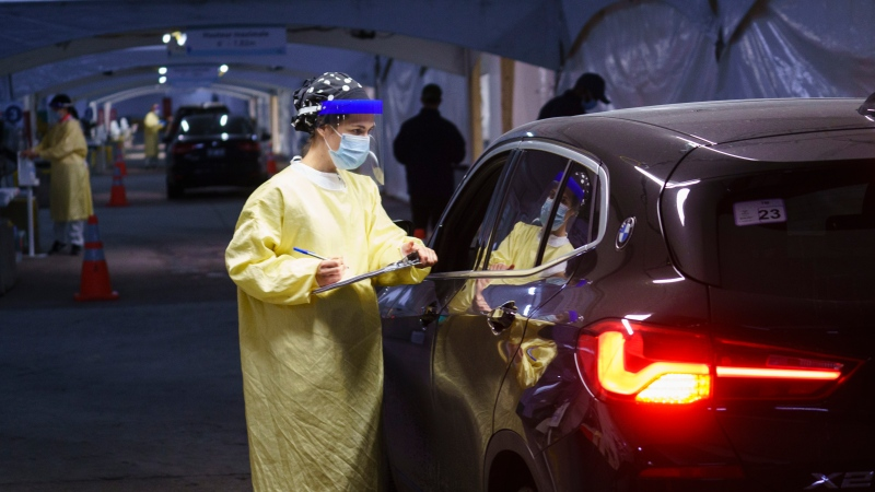 A nurse registers a patient at a drive-in COVID-19 clinic in Montreal, on Wednesday, October 21, 2020. THE CANADIAN PRESS/Paul Chiasson