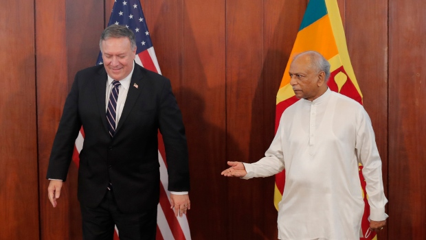 Sri Lankan Foreign Minister Dinesh Gunawardena gestures towards U.S. Secretary of State Mike Pompeo before their meeting in Colombo, Sri Lanka, Wednesday, Oct. 28, 2020. (AP Photo/Eranga Jayawardena, Pool)