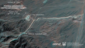 This Monday, Oct. 26, 2020, satellite image from Planet Labs Inc. that has been annotated by experts at the James Martin Center for Nonproliferation Studies at Middlebury Institute of International Studies shows construction at Iran's Natanz uranium-enrichment facility that experts believe may be a new, underground centrifuge assembly plant. (Planet Labs Inc. via AP)