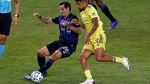 Montreal Impact defender Jorge Luis Corrales (26) controls the ball in front of Nashville SC midfielder Anibal Godoy (20) during the first half of an MLS soccer match Tuesday, Oct. 27, 2020, in Harrison, N.J. (AP Photo/Adam Hunger)
