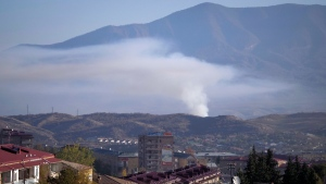 Smoke rises after shelling by Azerbaijan's artillery during a military conflict in Stepanakert, Nagorno-Karabakh, on Oct. 24, 2020. (AP)