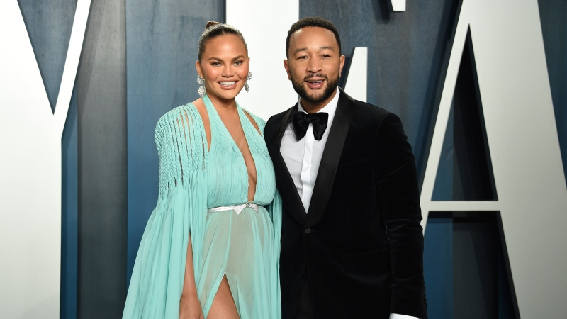 This Feb. 9, 2020 file photo, Chrissy Teigen, left, and John Legend arrive at the Vanity Fair Oscar Party in Beverly Hills, Calif. (Evan Agostini/Invision/AP)
