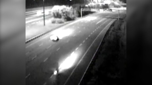 Ontario Provincial Police shared this image of a motorcycle driver on Highway 417 eastbound near Moodie Drive at around 12:25 a.m. Sept. 12, 2020. The motorcycle driver apparently stopped briefly at the scene of a fatal crash. Police would like to speak with this driver. (Image submitted by Ontario Provincial Police)
