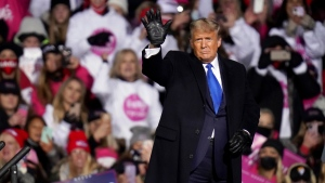 U.S. President Donald Trump waves after speaking at a campaign rally in Omaha, Neb., Tuesday, Oct. 27, 2020. (AP Photo/Nati Harnik)