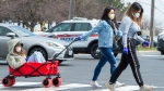 Three women cross a street on the way to the grocery store in Markham, Ontario on Wednesday April 15, 2020. THE CANADIAN PRESS/Frank Gunn