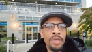 Dorre Love stand outside the Vancouver Police Department. (Dorre Love/YouTube)