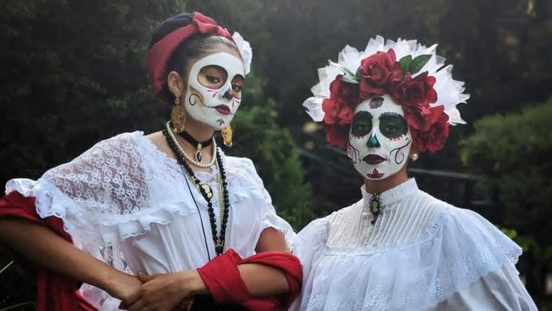 Paloma Torres pictured with Susana Vitales, another member of the Ballet Folkorico Puro Mexico, for Dia de los Muertos in 2018. (Photo provided by Paloma Torres)