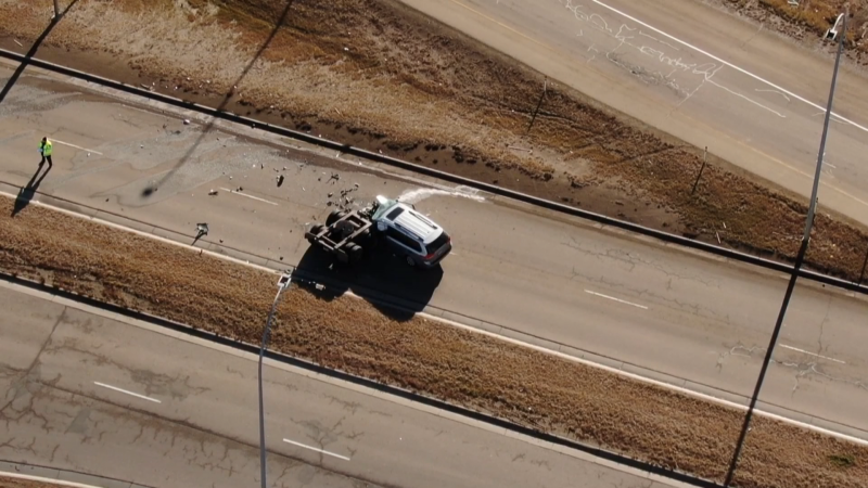 A 36-year-old woman is dead after a wheel hit her vehicle on Lessard Road just off Anthony Henday Drive on Wednesday, Oct. 28, 2020. (CTV News Edmonton)