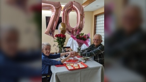 Marjorie and Leonard Patterson hold hands on their 70th anniversary at Grove Park Home in Barrie, Ont., on Wed., Oct. 28, 2020. (Supplied)