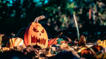 Jack-O'-Lantern on the ground. (Photo by Vlad Chetan from Pexels)