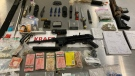Two firearms, two replica handguns, knives, swords and other weapons are among the items seized by a B.C. gang enforcement team on Vancouver Island (Combined Forces Special Enforcement Unit of British Columbia)