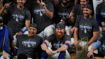 Los Angeles Dodgers manager Dave Roberts and third baseman Justin Turner pose for a group picture after the Dodgers defeated the Tampa Bay Rays 3-1 in Game 6 to win the baseball World Series, Tuesday, Oct. 27, 2020, in Arlington, Texas. (AP Photo/Eric Gay)