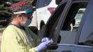 A health care worker conducts a COVID-19 test at the drive-thru testing centre on Sperling Drive in Barrie, Ont. (Mike Arsalides/CTV News)