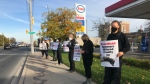 Protestors took to an Esso gas station in Windsor, Ont to protest the controversial Alaskan Iditarod dog-sled race on Wednesday, Oct. 28 2020. (Alana Hadadean/CTV Windsor)